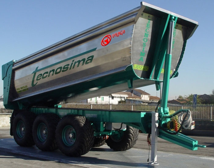 Rear-unloading bolted dump bin for agricultural vehicle.